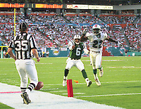 Ray Lucas (6) and Terrence Shaw (22) chase a ball as the field judge throws a penalty fllas as the Jets defeated the Dolphins 20-3 in Miami , FL on November 19, 2000. (Photo by Brian Cleary / www.bcpix.com)