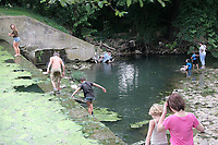 MEGAN DAVIS MCDONALD COUNTY PRESS/Cut-off jeans, swim suits, and tank tops are popular attire during Southwest City's Third of July Celebration. Kids of all ages gather along Honey Creek, the lake, and the dam to cool off in the running water.