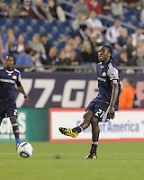 New England Revolution midfielder Shalrie Joseph (21) passes the ball. The New England Revolution defeated the New York Red Bulls, 3-2, at Gillette Stadium on May 29, 2010.