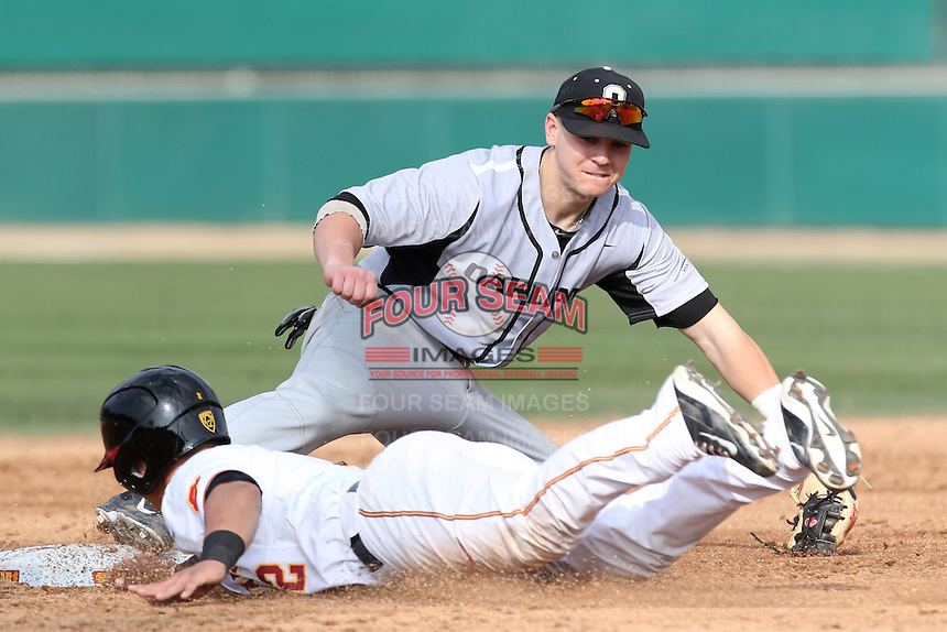 Mike Brousseau (10) of the Oakland Grizzlies during a game against the Southern California Trojans at Dedeaux Field on February 21, 2015 in Los Angeles, California. Southern California defeated Oakland, 11-1. (Larry Goren/Four Seam Images)