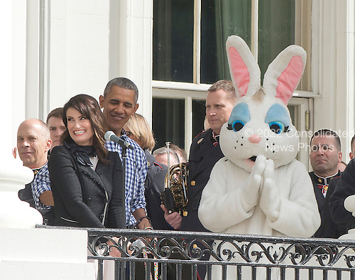 United States President Barack Obama looks on as Idina Menzel sings the National Anthem as the President and first lady Michelle Obama host the 2016 White House Easter Egg Roll on the South Lawn of the White House in Washington, DC on Monday, March 28, 2016.<br /> Credit: Ron Sachs / CNP