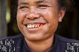 INDONESIA, Flores, Waturaka Village, a woman smiles and chews Beetle Nut