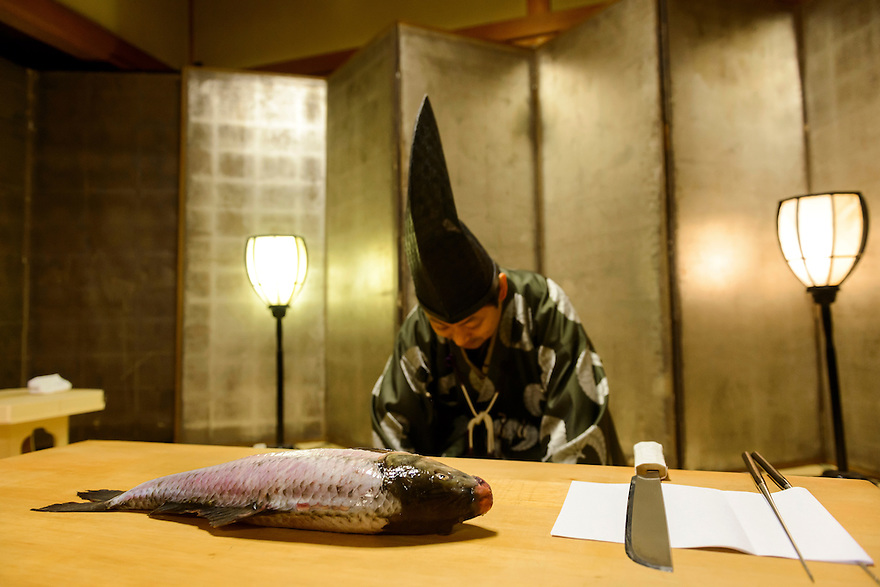"Ikama Masayasu prepares a carp in a ""shikibocho"" Imperial Knife Ceremony, Ginza Restaurant, Asakuchi City, Okayama Pref, Japan, January 28, 2014. Ikama Masayasu is 29th head of the Kyoto Ikama school of shikibocho. Shikibocho is a Shinto ceremony in which raw fish or fowl is filleted using only a knife and chopsticks. During the ceremony which dates back to the Japanese Imperial Court of 859 the master does not touch the fish with his hands."