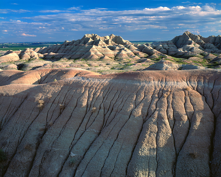 Sunset light on eroded formations in the Badlands; Badlands National Park, SD