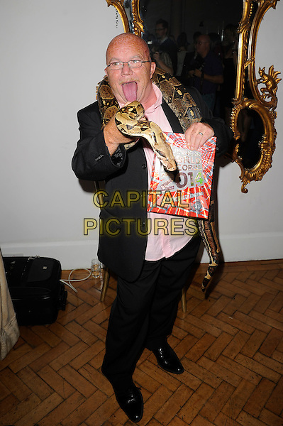 Stephen Taylor<br /> The Guinness World Records 2014 Launch Party, One Marylebone, London, England. <br /> 17th September 2013<br /> full length suit mouth open tongue glasses shirt jacket snake over shoulders mouth open<br /> CAP/MAR<br /> &copy; Martin Harris/Capital Pictures