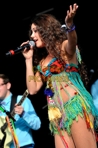 ELIZA DOOLITTLE.Camp Bestival at Lulworth Castle & Park, Dorset, England..July 31st 2011.stage concert live gig performance music half length red bra green yellow feathers shorts top hand arm fringed singing side profile .CAP/ROS.©Steve Ross/Capital Pictures