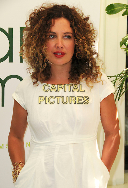 TARA SMITH .Launch party for the Tara Smith Hair Products, Hemple Hotel, London, England, UK,.July 15th 2008..half length white dress curly hair red lipstick .CAP/CAS.©Bob Cass/Capital Pictures