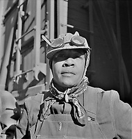 Workin' on the Railroad: Portrait of Abbie Caldwell, employed in the Atchison, Topeka and Santa Fe Railroad yard to clean out potash cars. Clovis, New Mexico. March 1943.<br /> <br /> Photo by Jack Delano.