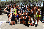 MIAMI BEACH, FL - JUNE 21: DJ Irie poses for a group picture with Barry's BootCamp after a booth camp workout by the pool side during Irie Weekend-IWX - BBQ Beach Bash Pool Party at National Hotel on Saturday June 21, 2014 in Miami Beach, Florida. (Photo by Johnny Louis/jlnphotography.com)