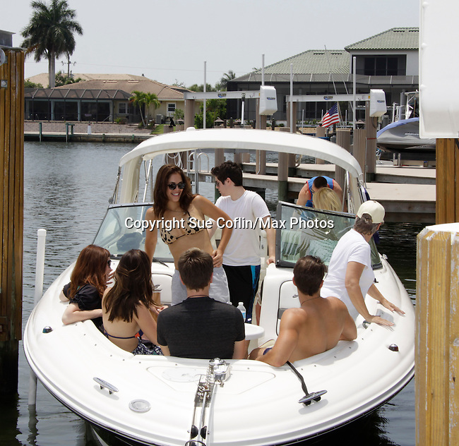 John Driscoll, Melissa Archer, Kristen Alderson, Scott (boat owner), Bryan Craig & Kelly Thiebaud - General Hospital at 15th Soapfest Weekend 2014 on May 24, 2104 on Marco Island, Florida relax after giving their time charity on a boat.  (Photo by Sue Coflin/Max Photos)