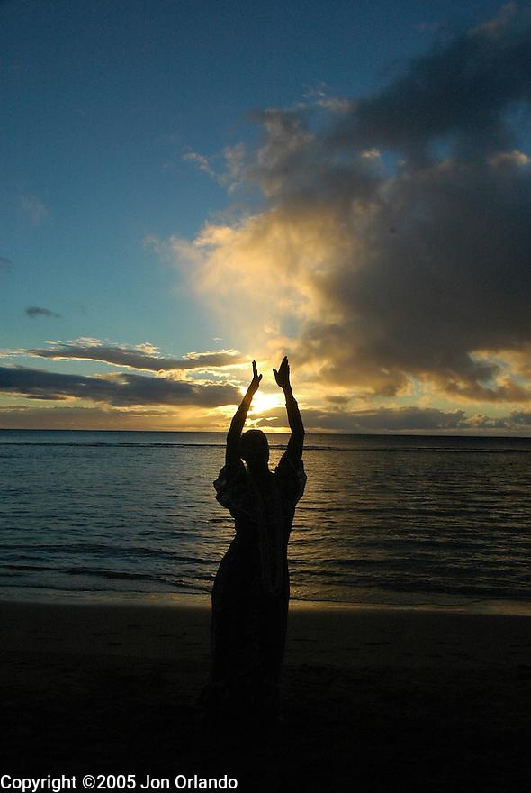 Hula dancer at sunset on the island of Kauai.  Shot on location for Idanha Films.