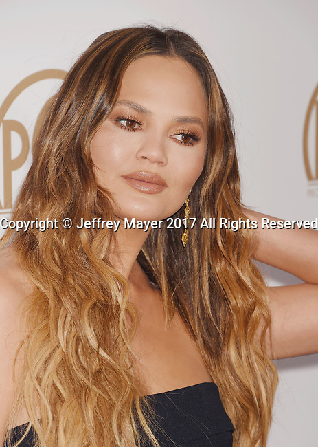 HOLLYWOOD, CA - JANUARY 28: Model Chrissy Teigen arrives at the 28th Annual Producers Guild Awards at The Beverly Hilton Hotel on January 28, 2017 in Beverly Hills, California.