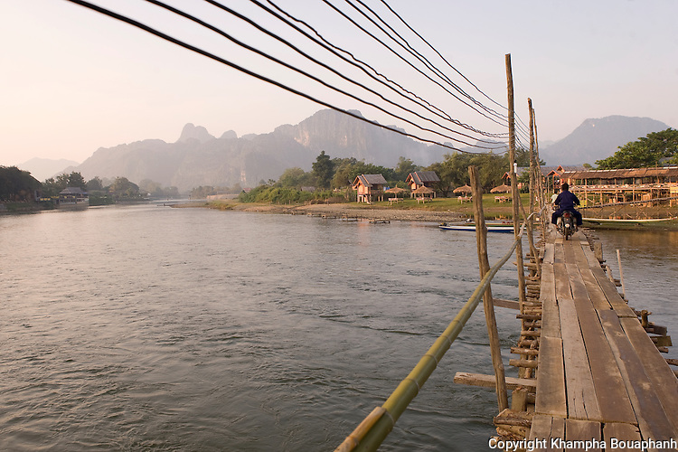 Locals cross Nam Song in Vang Vieng, Laos on November 4, 2009.   (Photo by Khampha Bouaphanh)