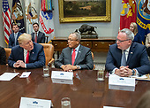 United States President Donald J. Trump, left, directs remarks to Jim Carroll, Deputy Director of the Office of National Drug Control Policy, right, as he announces a grant for drug-free communities support program in the Roosevelt Room of the White House in Washington, DC on Wednesday, August 29, 2018.  Looking on at center is General Arthur T. Dean, Community Anti-Drug Coalitions of America.  Following his remarks the President took a few questions from the press.<br /> Credit: Ron Sachs / CNP