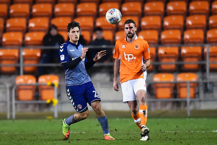 Blackpool's Clark Robertson competes with Charlton Athletic's Lewis Page<br /> <br /> Photographer Richard Martin-Roberts/CameraSport<br /> <br /> The EFL Sky Bet League One - Blackpool v Charlton Athletic - Tuesday 13th March 2018 - Bloomfield Road - Blackpool<br /> <br /> World Copyright &copy; 2018 CameraSport. All rights reserved. 43 Linden Ave. Countesthorpe. Leicester. England. LE8 5PG - Tel: +44 (0) 116 277 4147 - admin@camerasport.com - www.camerasport.com