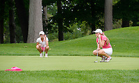 Notre Dame Academy's Stephanie Stead (right) and Oregon's Taylor McCorkle line up their putts on the first hole of Maple Bluff Country Club during the Crusade Fore A Cure girls golf tournament, hosted by Madison Edgewood on Monday, August 31, 2015 in Maple Bluff, Wisconsin