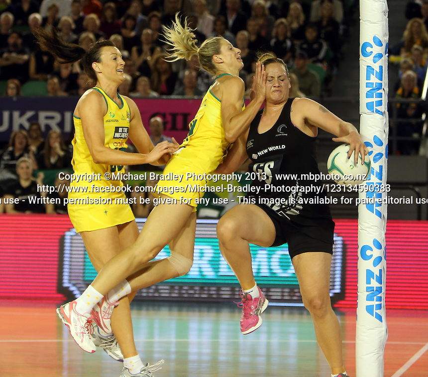 07.10.2013 Silver Fern Cathrine Latu and Australian Diamond Laura Geitz in action during the Silver Ferns V Australian Diamonds Netball Series played at the Rod Laver Arena in Melbourne Australia. Mandatory Photo Credit ©Michael Bradley.