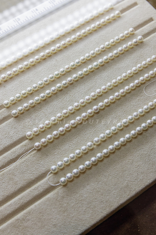 Toba, Mie Prefecture, Japan, October 30 2016 - Pearls on display in the museum on Mikimoto Pearl island, a museum about pearls, pearl cultivation and Mikimoto Kokichi, the pioneer who first succeeded in cultivating pearls.