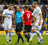 Leeds United's Liam Cooper has a word with referee Jeremy Simpson<br /> <br /> Photographer Alex Dodd/CameraSport<br /> <br /> The EFL Sky Bet Championship - Leeds United v Brentford - Saturday 6th October 2018 - Elland Road - Leeds<br /> <br /> World Copyright &copy; 2018 CameraSport. All rights reserved. 43 Linden Ave. Countesthorpe. Leicester. England. LE8 5PG - Tel: +44 (0) 116 277 4147 - admin@camerasport.com - www.camerasport.com
