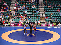 Jordan Burroughs of the United States (cq, in blue), wrestles Ilya Abelev of Canada in the semi final round of the Pan American Championships at Dr. Pepper Arena in Frisco, Texas, Saturday, Saturday 27, 2015. Burroughs went on to win the match 13-2 and eventually win gold at the event.<br /> <br /> Photo by Matt Nager