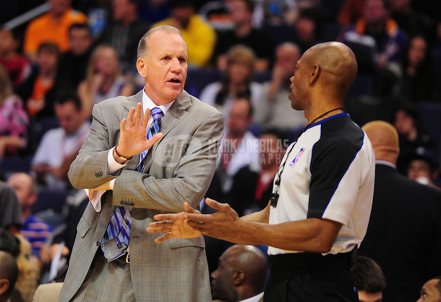 Dec. 28, 2011; Phoenix, AZ, USA; Philadelphia 76ers head coach Doug Collins argues with NBA referee Tom Washington during game against the Phoenix Suns at the US Airways Center. The 76ers defeated the Suns 103-83. Mandatory Credit: Mark J. Rebilas-USA TODAY Sports