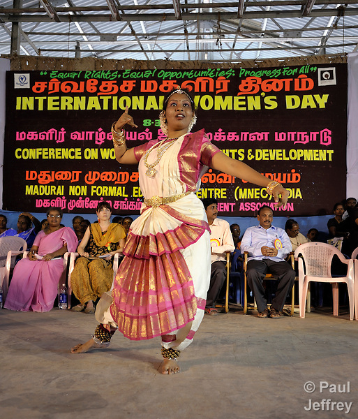 Shilpa Manoharan dances during a rally celebrating International Women's Day in Madurai, a city in Tamil Nadu state in southern India.