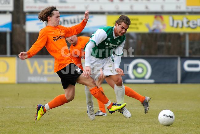 HARDENBERG - Voetbal, HHC Hardenberg - ARC, Topklasse,  Sportpark De Boshoek. seizoen 2011-2012, 25-02-2012, HHC speler Stijn Pol (l) haalt ARC speler Mike Dam onderuit.