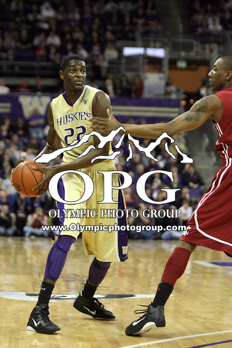 Feb 27, 2011:  Washington's #22 Justin Holiday passes the ball to an open teammate against Washington State.  Washington State defeated Washington 80-69 at Alaska Airlines Arena Seattle, Washington...