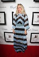 HOLLYWOOD, CA - NOVEMBER 5: Kaley Cuoco, at 7th Annual Stand Up For Pits at Avalon Hollywood In Hollywood, California on November 5, 2017. Credit: Faye Sadou/MediaPunch