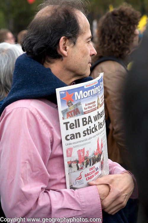 May Day march and rally at Trafalgar Square, May 1st, 2010 man holding Morning Star communist newspaper