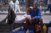 Rio de Janeiro, Brazil. Street kid couple with their belongings on a street.