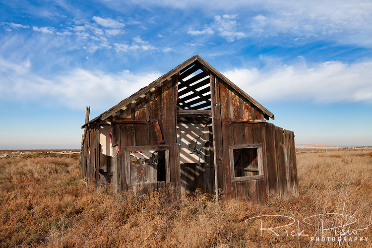 The Recreation, the cabin of Ann and John Byrnes that was built in 1903, now sits abandoned and slowly sinking into the marsh at the ghost town of Drawbridge in southern San Francisco Bay. Drawbridge was a hunting village started in the 1880's with the last resident leaving in the 1970's.