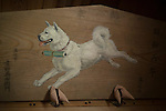 Photo shows a painting of Shiro, an Akita Inu,  which tried to rescue his master over 400 years ago after he was caught hunting with out his permit inside Roken Jinja, a shrine in Odate City, Akita Prefecture Japan. Shiro travelled a total of 60 km to collect and deliver the permit, but retuned to find his master had already been executed.  Photographer: Rob Gilhooly