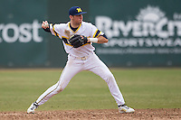 Michigan Wolverines second baseman Ramsey Romano (4) makes a throw to first base during the NCAA baseball game against the Washington Huskies on February 16, 2014 at Bobcat Ballpark in San Marcos, Texas. The game went eight innings, before travel curfew ended the contest in a 7-7 tie. (Andrew Woolley/Four Seam Images)