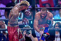 """Fairfax, VA - May 11, 2019: Julian J-Rock"""" Williams lands a right hand against Jarrett """"Swift"""" Hurd during Jr. Middleweight title fight at Eagle Bank Arena in Fairfax, VA. Julian Williams defeated Hurd to take home the IBF, WBA and IBO Championship belts by unanimous decision. (Photo by Phil Peters/Media Images International)"""