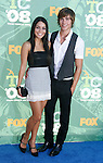 Actors Vanessa Hudgens and Zac Efron arrive at the 2008 Teen Choice Awards at the Gibson Amphitheater on August 3, 2008 in Universal City, California.