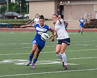 Boston Breakers forward Lianne Sanderson (10) and Sky Blue FC defender Madeleine Thompson (25) battle for the ball.  In a National Women's Soccer League Elite (NWSL) match, Sky Blue FC defeated the Boston Breakers, 3-2, at Dilboy Stadium on June 16, 2013