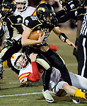 WATERBURY, CT-112117JS16- WCA's Christian Calle (23) gets brought down by Gilbert-Northwestern's Liam Duran (50) during their game Tuesday at Municipal Stadium in Waterbury. <br /> Jim Shannon Republican-American