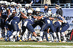 Navy Midshipmen players get ready for action before the Armed Forces Bowl game between the Middle Tennessee Blue Raiders and the Navy Midshipmen at the Amon G. Carter Stadium in Fort Worth, Texas. Navy defeated Middle Tennessee 24 to 6.