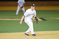Wake Forest Demon Deacons shortstop Conor Keniry (14) on defense against the Duke Blue Devils at Wake Forest Baseball Park on April 25, 2014 in Winston-Salem, North Carolina.  The Blue Devils defeated the Demon Deacons 5-2.  (Brian Westerholt/Four Seam Images)