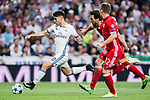 Marco Asensio Willemsen (l) of Real Madrid battles for the ball with Mats Hummels and Joshua Kimmich of FC Bayern Munich during their 2016-17 UEFA Champions League Quarter-finals second leg match between Real Madrid and FC Bayern Munich at the Estadio Santiago Bernabeu on 18 April 2017 in Madrid, Spain. Photo by Diego Gonzalez Souto / Power Sport Images
