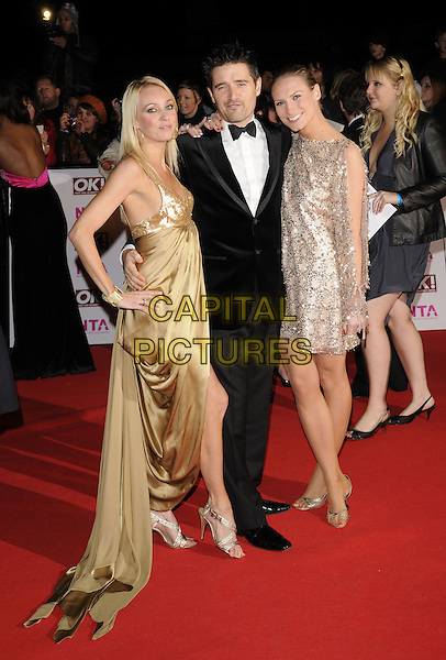CAMILLA DALLERUP & GUESTS .arriving at the National Television Awards held at the Royal Albert Hall,  London, England, 29th October 2008..red carpet arrivals full length black suit silver dress bow tie tuxedo gold silk satin long hand on hip .CAP/FIN.©Steve Finn/Capital Pictures