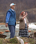 (Tuzla, Bosnia, 02/07/02) A couple says goodbye as members of the Massachusetts Army National Guard maintain order in the aftermath of ethnic cleansing and prevent a resumption of violence that ravaged the former Yugoslav state by provide security for displaced residents returning to rebuild their shattered homes in Northern Bosnia on Thursday, February 07, 2002. Staff photo by Christopher Evans