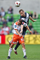 MELBOURNE, AUSTRALIA - SEPTEMBER 12, 2010: Massimo Murdocca from the Roar competes for the ball against Grant Brebner from the Victory in Round 6 of the 2010 A-League between the Melbourne Victory and Brisbane Roar at AAMI Park on September 12, 2010 in Melbourne, Australia. (Photo by Sydney Low / Asterisk Images)