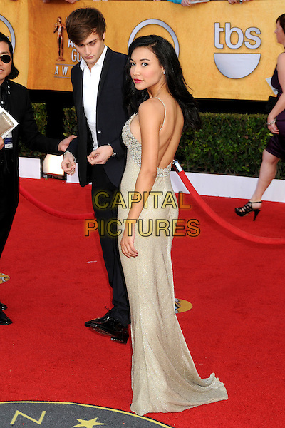 DOUGLAS BOOTH & NAYA RIVERA.17th Annual Screen Actors Guild Awards held at The Shrine Auditorium, Los Angeles, California, USA..January 30th, 2011.arrivals full length beige dress back behind rear looking over shoulder backless back behind rear black suit SAG.CAP/ADM/BP.©Byron Purvis/AdMedia/Capital Pictures.