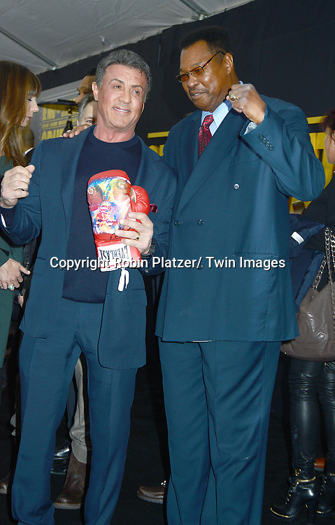 "Sylvester Stallone and Larry Holmes attend the World Premiere of ""Grudge Match"" at the Ziegfeld Theatre in New Yok City on December 16, 2013."