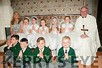 Muinteoir Eibhlin class from Gael Scoil, Listowel who received their 1st communion from Canon Declan O'Connor at St. Mary's Church, Listowel on Saturday last.