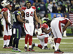 Seattle Seahawks running back Marshawn Lynch (24) and  Arizona Cardinals tight end Jermaine Gresham (84) joke around during an injury time out at CenturyLink Field in Seattle, Washington on November 15, 2015. The Cardinals beat the Seahawks 39-32.   ©2015. Jim Bryant photo. All Rights Reserved.