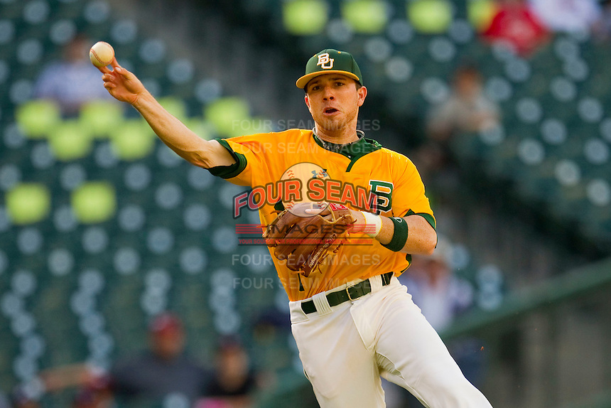 Shortstop Landis Ware #5 of the Baylor Bears makes an off-balance throw to first base against the Rice Owls at Minute Maid Park on March 6, 2011 in Houston, Texas.  Photo by Brian Westerholt / Four Seam Images