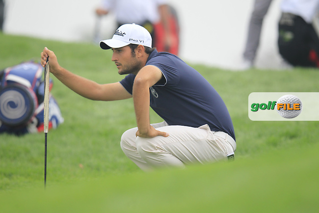 Alexander Levy (FRA) on the 1st green during Saturay's Round 3 of the 2014 BMW Masters held at Lake Malaren, Shanghai, China. 1st November 2014.<br /> Picture: Eoin Clarke www.golffile.ie
